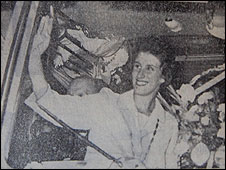 Dorothy waves to Cudworth from her homecoming bus full of flowers, 1960