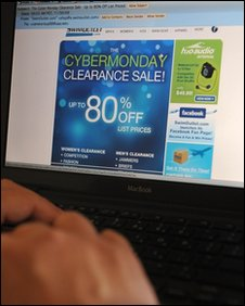 "A man looks at a ""Cyber Monday"" advertisement"