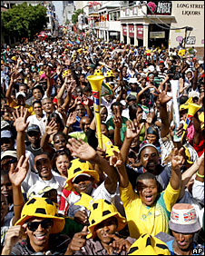 Fans await the draw at the fan festival on Log Street in Cape Town