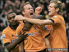 Jody Craddock (centre) is congratulated after his goal