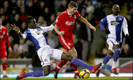 Blackburn defender Christopher Samba challenges Liverpool captain Steven Gerrard
