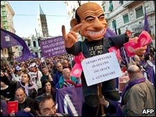 Protesters carry a Berlusconi puppet in Rome