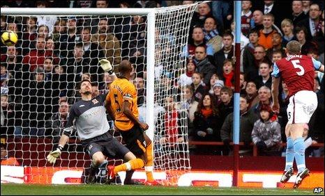 Aston Villa's Richard Dunne opens the scoring against Hull