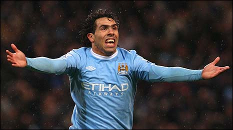 Carlos Tevez celebrates putting Man City ahead