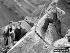 Corncockle Quarry, Lochmaben. Dumfriesshire. A photograph taken at the base of the quarry. Close-up view of splitting the sandstone by the 'chisel wedge' method. (1937)