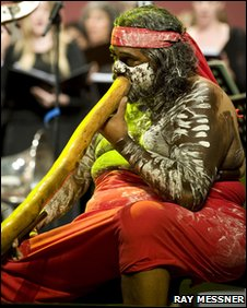 Australian aboriginal man playing didgeridoo at opening ceremony of the Parliament of the World's Religions in Melbourne. Photo: Ray Messner