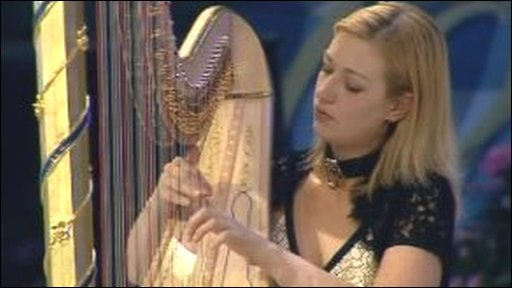 Jemima Philips playing the harp in 2006