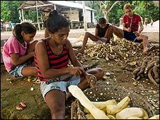 Paulo Dos Santos' family prepare food