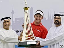 Lee Westwood receives the Race to Dubai trophy