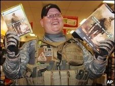 Man holding video games