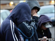 Young men in hooded tops