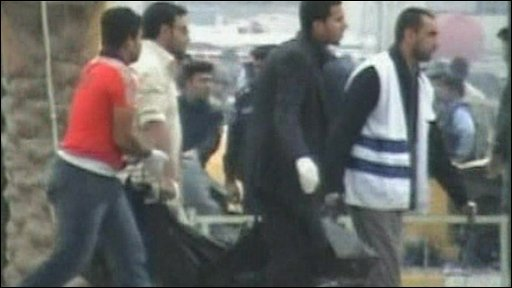 Men carrying body in bodybag