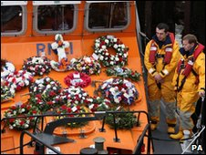 Memorial wreaths are taken out to sea on board the Earl and Countess Mountbatten of Burma lifeboat