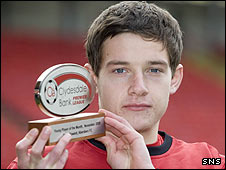 Peter Pawlett shows off his award