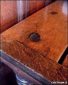 The scorch mark on the table in Chetham's Audit Room