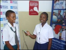 Two students in Tanzania standing with microphone