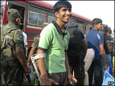 A former child soldier of the Tamil Tiger rebels leaves a rehabilitation centre to enrol in a school, in Vavuniya, Sri Lanka, on Oct 31, 2009