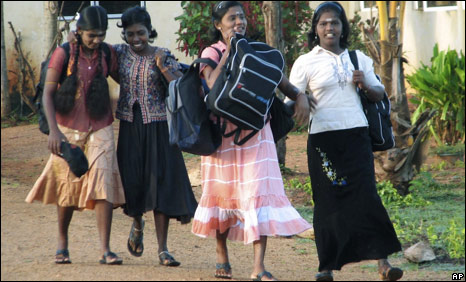A group of former child soldiers of the Tamil Tiger rebels leave a rehabilitation centre to enrol in a school, in Vavuniya, Sri Lanka, on Oct 31, 2009