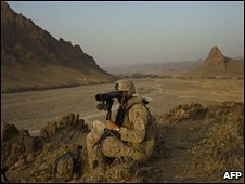 US soldiers looks through binoculars in Helmand province
