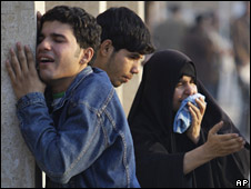 Mourners crying at a Baghdad hospital