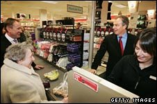 Tony Blair chats to customers at M&S till