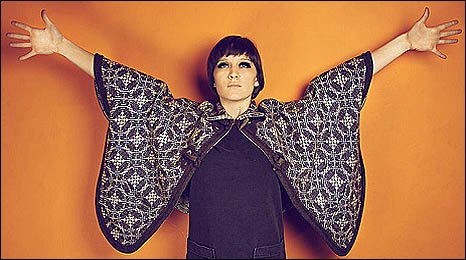 Image of Cate Le Bon with arms outstretched