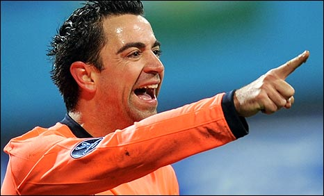 Xavi celebrates scoring for Barcelona