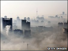 An aerial view of buildings standing out amid haze engulfing Wuhan, central China