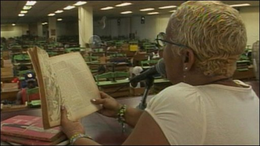 Woman reads to workers