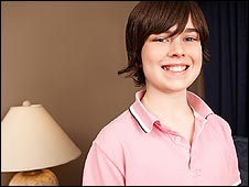 Boy in pink shirt