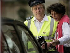 Traffic warden issuing ticket in London
