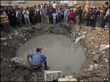 The crater left by a bomb at a Baghdad school