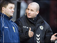 St Mirren manager Gus MacPherson chats to fourth official Steve Nicholls
