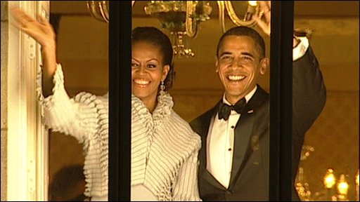 Barack and Michelle Obama greet crowds at the Grand Hotel in Oslo