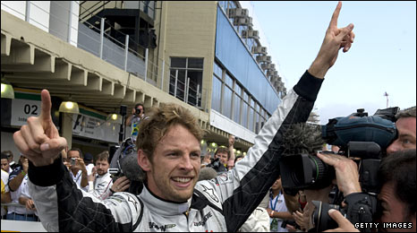 Jenson Button celebrates his 2009 world title success