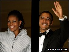 Michelle and Barack Obama waving from balcony of hotel (10/12/09)