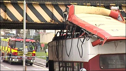 Roof of bus ripped off after hitting bridge