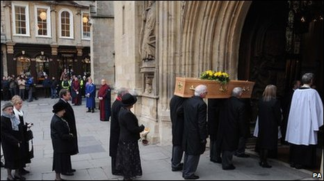 Funeral procession leading into Bath Abbey