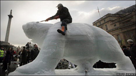 Polar bear, carved out of ice, in Trafalgar Square