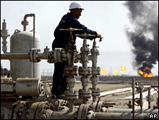 Worker operates valves at Rumaila oil field, near Basra, southern Iraq