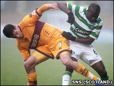Lukas Jutkiewicz (left) and Celtic's Landry N'Guemo battle for the ball