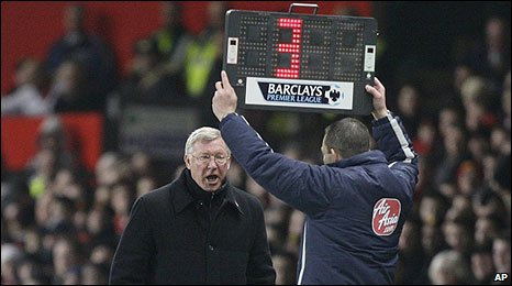 Sir Alex Ferguson and fourth official Michael Jones