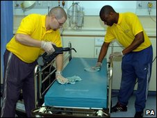 Hospital cleaners steaming beds in a hospital