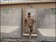 A British soldier walks from the accommodation block where Mr Brown spent the night