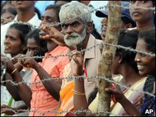 Internally displaced ethnic Tamils on the day President Mahinda Rajapakse visited to the Manik Farm refugee camp, in Vavuniya, on 9 December