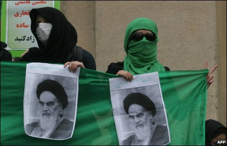 Iranian opposition supporters display posters of Ayatollah Khomeini at Tehran University, 13 December
