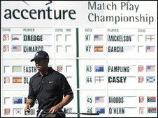 Tiger Woods in front of leaderboard at Accenture golf event