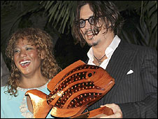 Johnny Depp with Bahamas film festival director Leslie Vanderpool