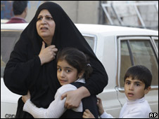 An Iraqi woman and her children at the site of a car bomb in Baghdad