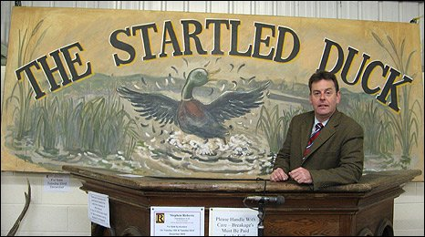 Sign from Kingdom's pub, The Startled Duck and Stephen Roberts from Watton Salerooms